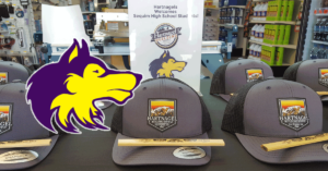 Sequim High Scool Wolf Logo with Hartnagel branded hats and carpenter pencils